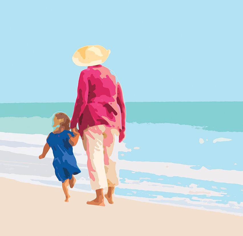 Une grand-mère et sa petite-fille marchent main dans la main sur la plage